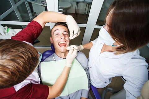 Dentist in Fayetteville NC Examining a Patient's Teeth